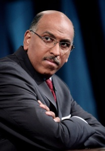 Michael Steele with arms folded
