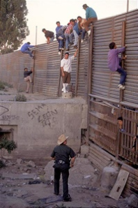 Immigrants caught climbing border fence