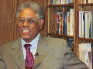 Thomas Sowell in his office